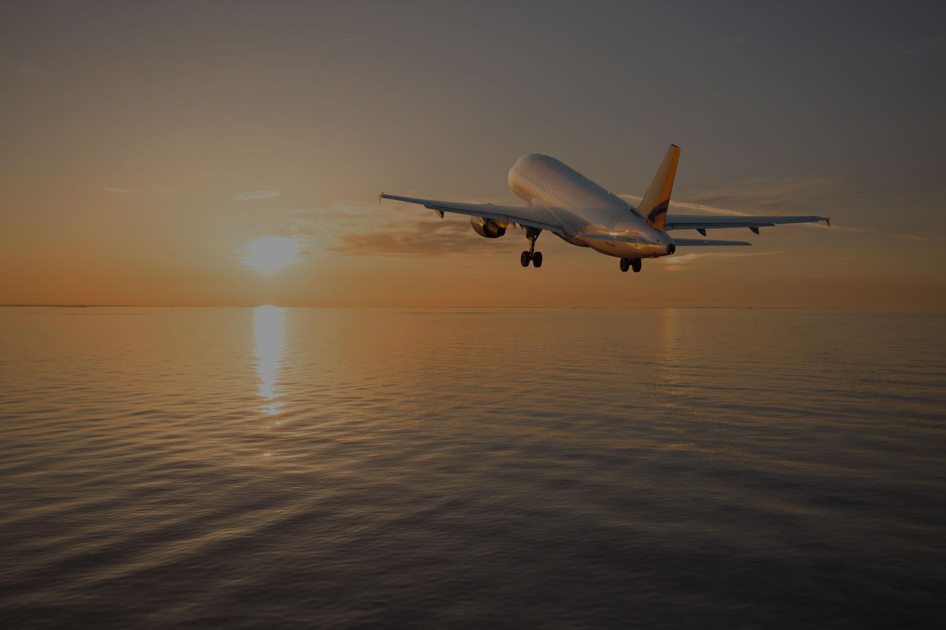 Aeroplane flying over ocean